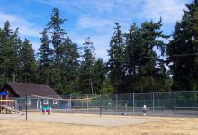 Three tennis courts, volleyball court, and kids playground